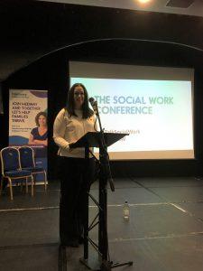 Sarah Henry speaking at lectern